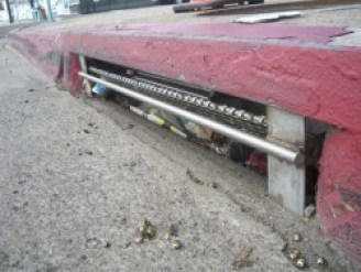 Curb inlets trap trash before it can makes its way to the ocean. Photo: City of San Diego Storm Drain Inlet Pilot Study report.