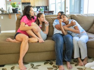 Tina Martinez (left) and Sri Ananthanarayanan sit with their daughters Avery, 10, and Maya, 13.
