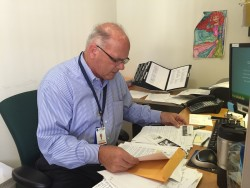 Ed Kirkpatrick is the director of Villa Coronado Skilled Nursing Facility. He is looking at the file he's colmpiled on 66 Garage.