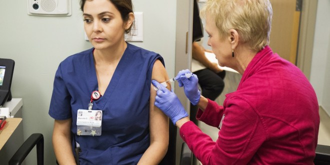 Flu triggers 'vaccinate or mask' rules at hospitals