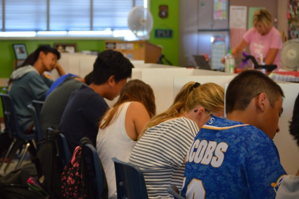 KT Martin's 8th grade English class at Challenger Middle School in Mira Mesa takes a test as the mercury in the classroom climbs past 92 degrees during 6th period. Martin said the conditions might cause her not to count the test toward students' grades. Photo by Ingrid Lobet