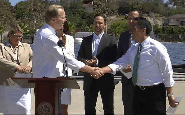San Diego Mayor Kevin Faulconer shakes the hand of Council President Todd Gloria at a press conference unveiling the mayor's climate action plan, Sept. 30, 2014. Tarryn Mento, KPBS