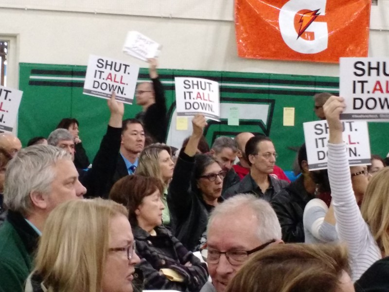 Signs like these asking for the complete closure of the Aliso Canyon Gas Storage facility, which Southern California Gas considers an essential asset, are beginning to appear at rallies held by residents of Porter Ranch. Jan. 9, 2016, Ingrid Lobet/inewsource