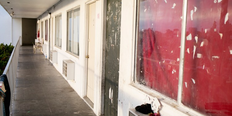 The outside of Rachel Quintana's 200-square-foot motel room in San Ysidro where she lives with her nine kids. Jan 15, 2016. Megan Wood, inewsource.