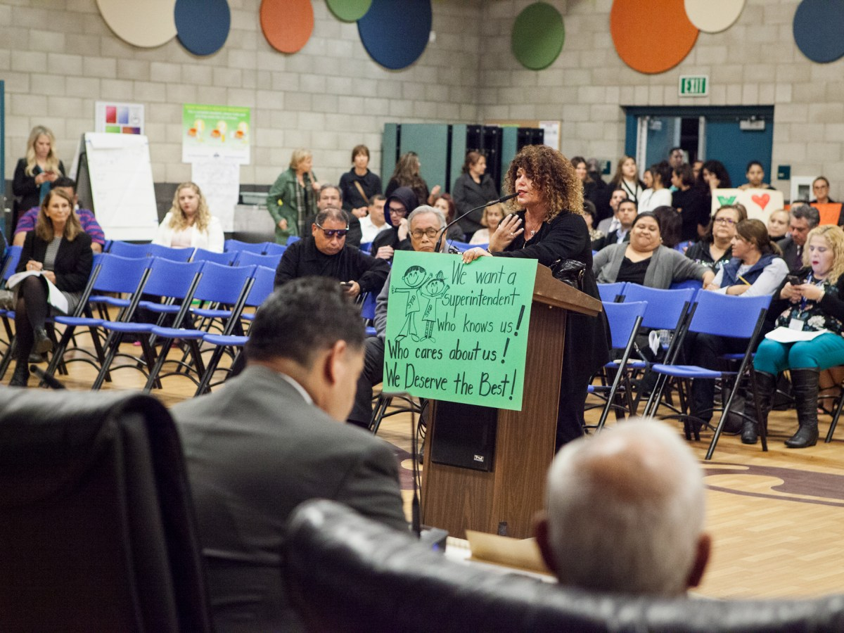 "Zenaida Rosario, a San Ysidro School District teacher, addresses the board at its Nov. 10, 2017, meeting. The district is undergoing a county-mandated ""extraordinary audit"" that the state is conducting. (Leonardo Castañeda/inewsource)"