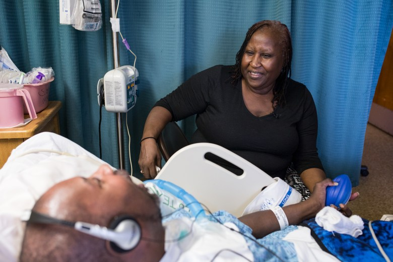 Gloria Hawkins sitting next to her son at the Vila Coronado Skilled Nursing Facility. (Megan Wood, inewsource)