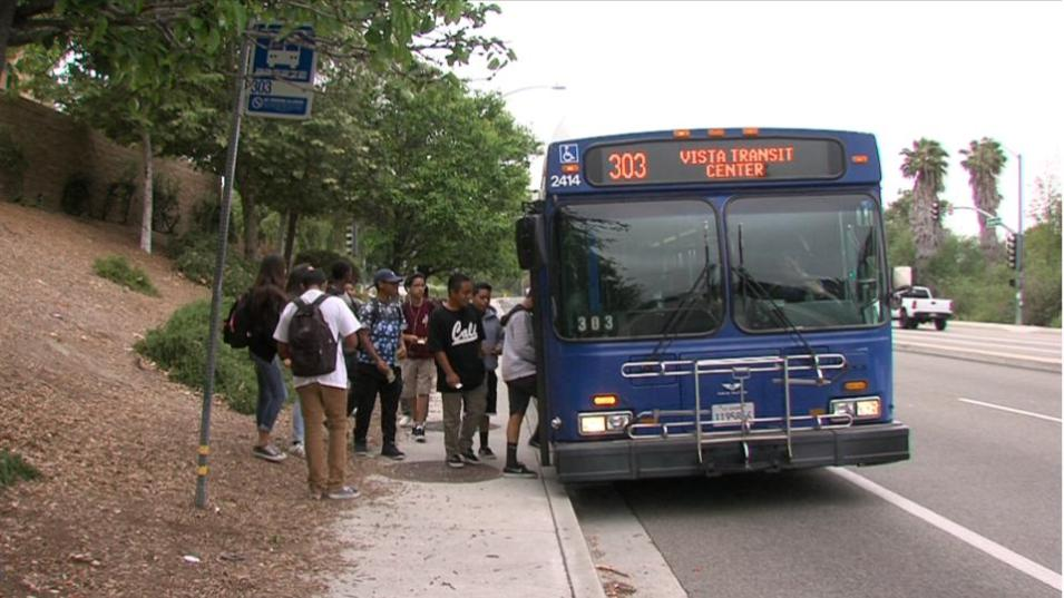 Roosevelt Middle School students board a North County Transit District Bus on North Santa Fe Avenue in Vista, June, 6, 2017. (Video screenshot by Katie Schoolov/KPBS)