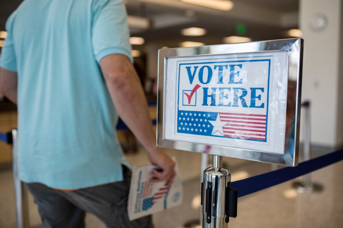 A voter is shown in the San Diego County Registrar of Voters Office in Kearny Mesa on June 4, 2018. (Megan Wood/inewsource)