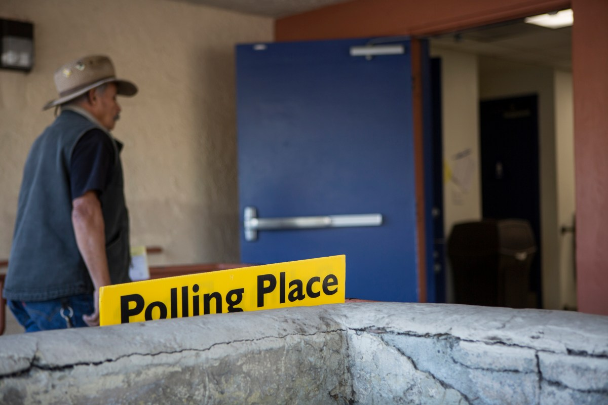 A voter walks into the San Ysidro Library to cast a ballot on Nov. 6, 2018.
