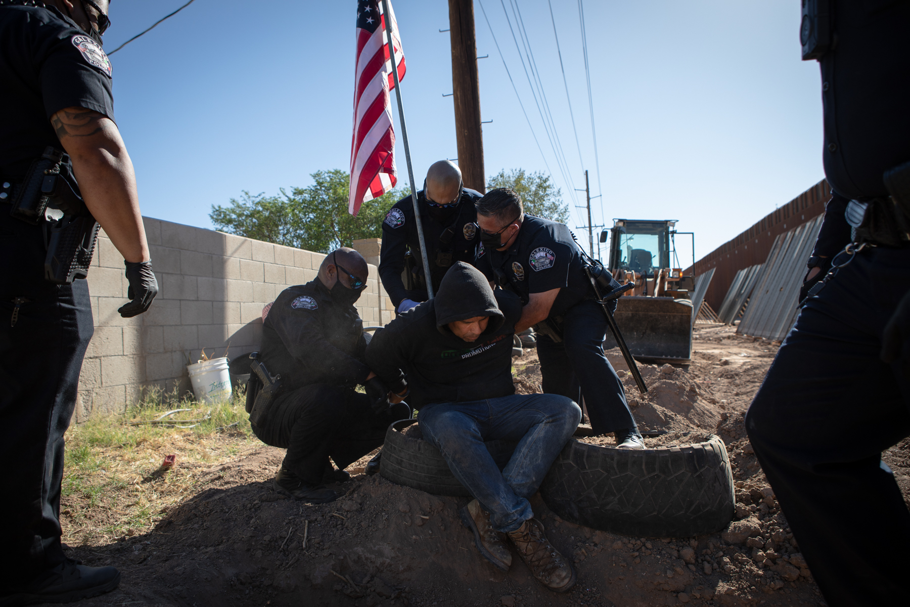 Police clear out farmworker encampment on contentious Calexico land