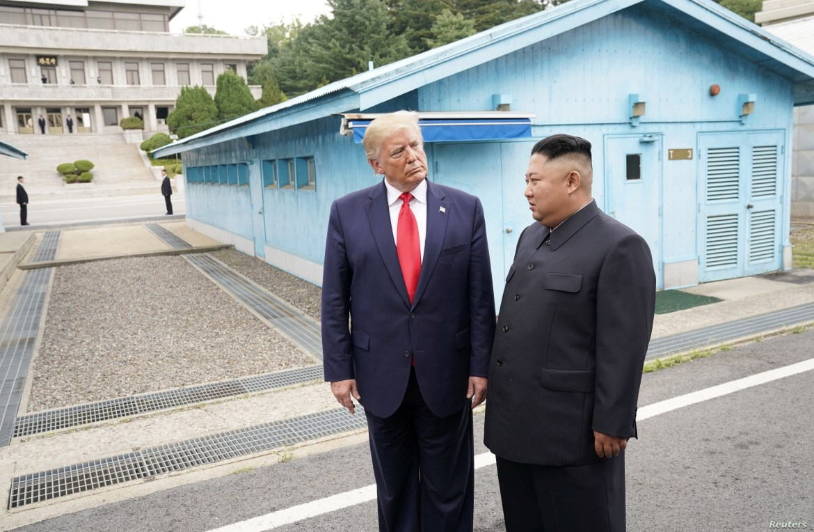 U.S. President Donald Trump meets with North Korean leader Kim Jong Un at the demilitarized zone separating the two Koreas, in Panmunjom, South Korea, June 30, 2019.