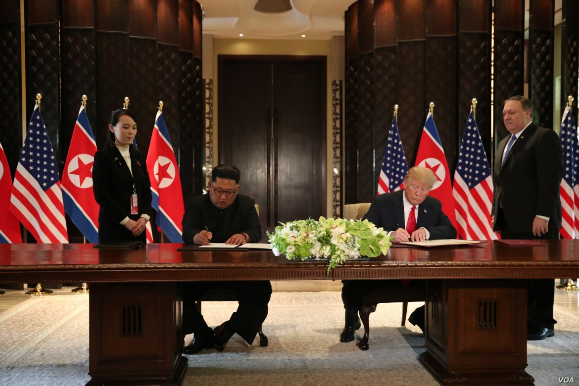 U.S. President Donald Trump and North Korea's leader Kim Jong Un sign documents that acknowledge the progress of the talks and pledge to keep momentum going, after their summit at the Capella Hotel on Sentosa island in Singapore, June 12, 2018.