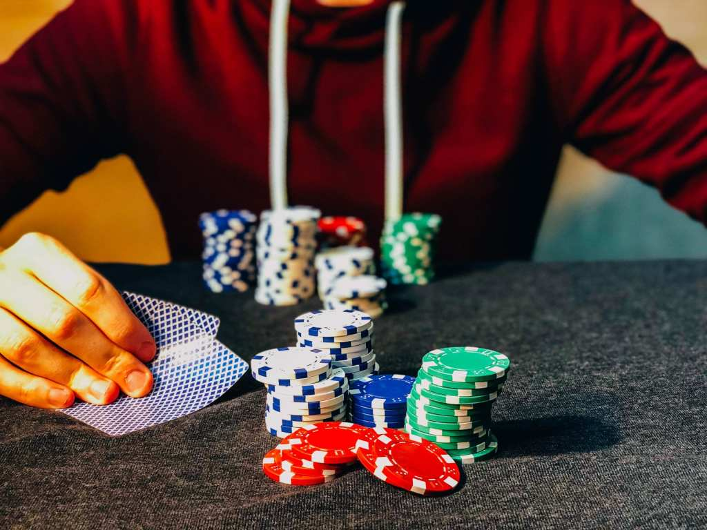 Big pile of poker chips symbolizing more is better Photo by Chris Liverani on Unsplash