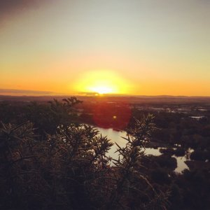 Sunrise from Arthurs Seat hill over Duddingston Loch in Edinburgh, Scotland