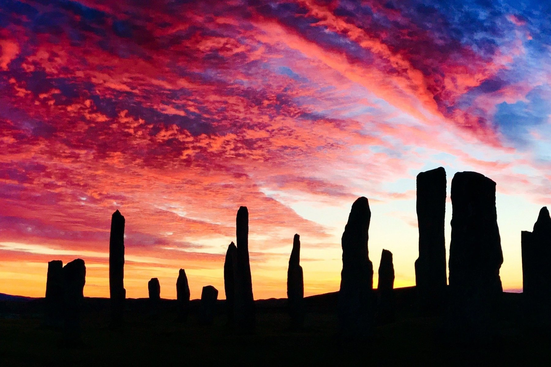 Private tours to see multicoloured sunsets over ancient standing stones, Scotland