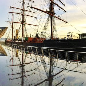 Tall ship named Discovery reflected in waterfront, Dundee, Scotland