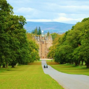 Fairytale Glamis Castle at the end of long driveway, Scotland