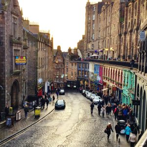 Colourful shops on curved street in Edinburgh, Scotland