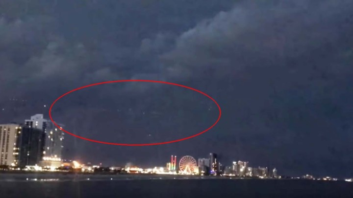 They record a huge UFO on a South Carolina beach during a thunderstorm