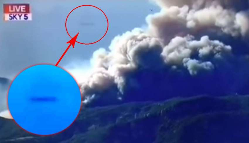 A cigar-shaped UFO bursts into the news broadcast on wildfires in California