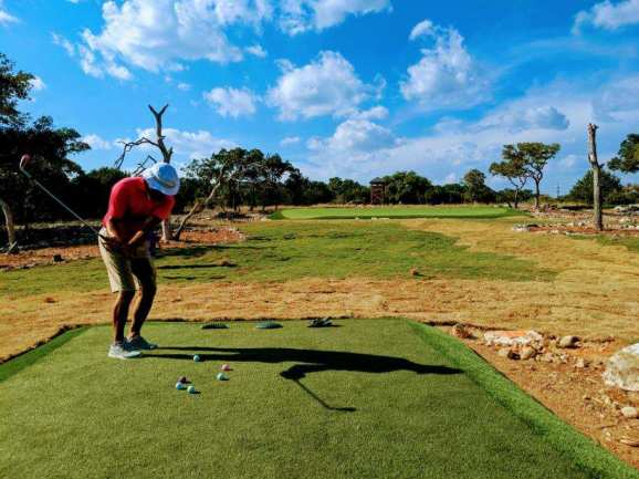 chipping onto private putting green
