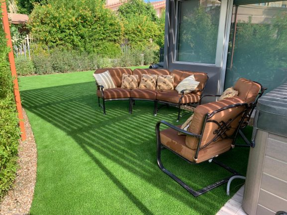 synthetic grass backyard lawn with lawn furniture