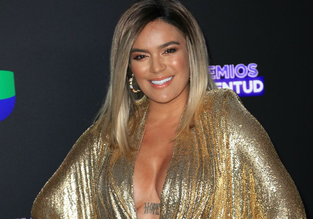 Karol G Wears Her Cleavage (And Her Tattoo) Wearing Only A Robe