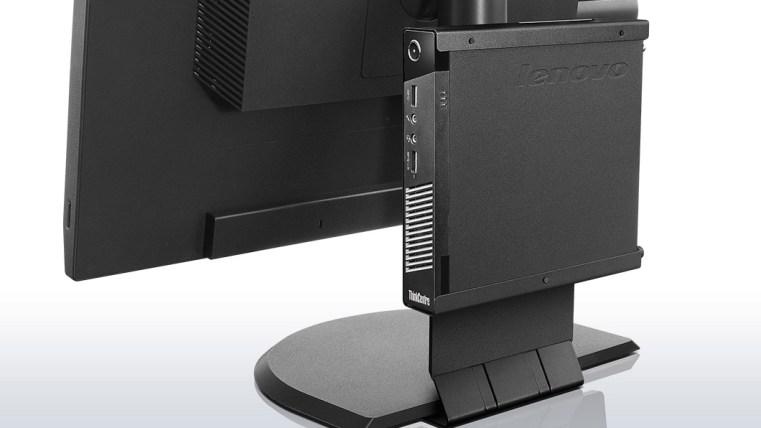Exemplo do M93p Tiny montado atrás de um monitor.