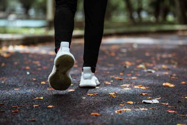 faceless person jogging in empty park