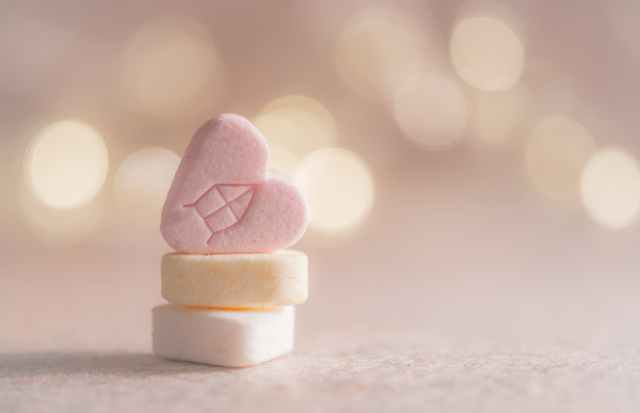 three beige yellow and pink heart marshmallows