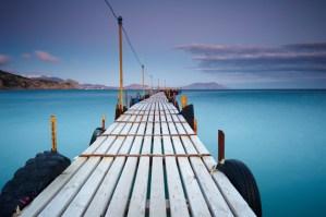 a pier leading into an ocean