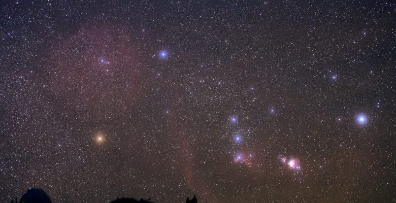 Constellation Orion with its vast nebulosity rises in the sky.