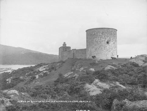 photo of a stone tower on a rocky coast.