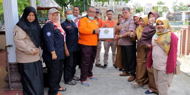 Satgas Pramuka Peduli Serahkan Bantuan dan Tinjau Lokasi Banjir Padang Pariaman