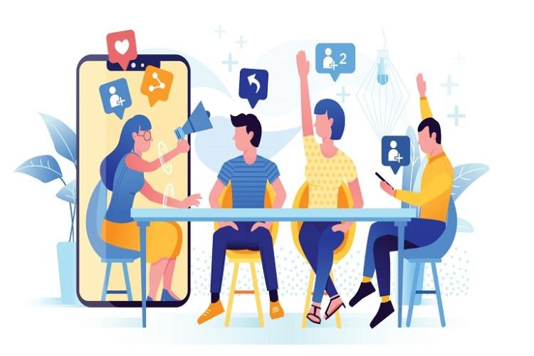 Imagen que muestra un celular, una mesa, sillas, personas e íconos de redes sociales