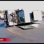 Driver flips vehicle in busy traffic