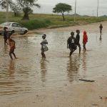 Woman dies in flooded riverbed