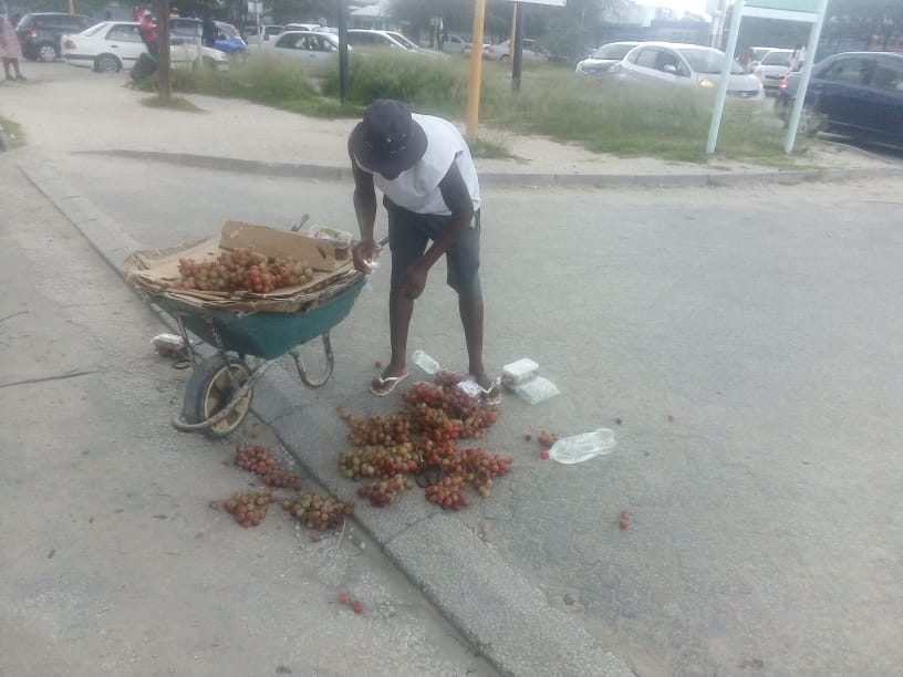 Hawker harassed security guards vendor wheelbarrow overturned Oshana Security guards Oshakati Intermediate Hospital grapes ground