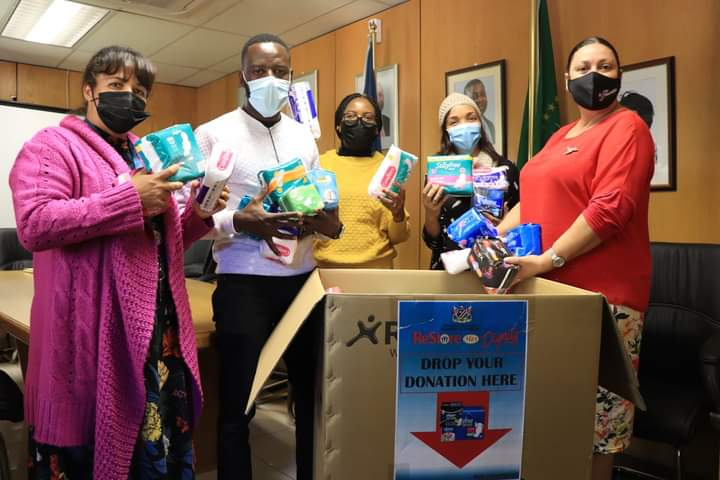 Justice officials donate pads female learner menstruation sanitary products