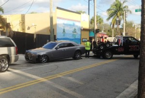 Ross' Rolls Royce being towed away after the shooting