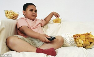 Overweight-Child-Eating-Snacks
