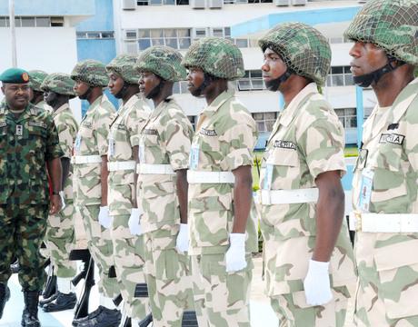 CHIEF OF ARMY STAFF, LT.-GEN. AZUBUIKE IHEJIRIKA (L), INSPECTING  PARADE OF GUARDS IN KADUNA