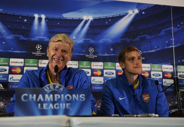 Arsene Wenger and Per Mertesacker at the Press Conference for Tonight's Group F Opener.