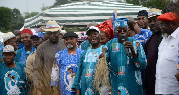 PART OF THE CROWD AT THE ALL PROGRESSIVES CONGRESS (APC) ANAMBRA STATE CANDIDATE DR. CHRIS NGIGE'S CAMPAIGN LAUNCH IN ONITSHA...RECENTLY. LEFT: APC LEADER ASIWAJU BOLA AHMED TINUBU SPEAKING AT THE RALLY...  WITH HIM (FROM RIGHT) ARE: CHIEF TOM IKIMI, IMO STATE GOVERNOR ROCHAS OKOROCHA, SECRETARY TO THE GOVERNMENT OF THE STATE OF OSUN ALHAJI MOSHOOD ADEOTI, APC INTERIM NATIONAL CHAIRMAN CHIEF BISI AKANDE, NGIGE, EKITI STATE GOVERNOR DR. KAYODE FAYEMI, EDO STATE GOVERNOR ADAMS OSHIOMHOLE, DR. OGBONNAYA ONU AND OTHERS (PHOTO CREDIT: THE NATION)
