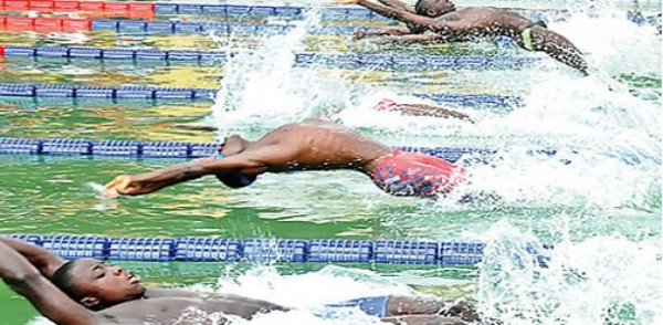 Swimmers at the Teslim Balogun Stadium Swimming Pool Facility.