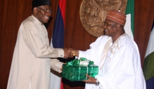 PRESIDENT GOODLUCK JONATHAN RECEIVES THE REPORT OF THE PRESIDENTIAL COMMITTEE ON PEACEFUL RESOLUTION OF SECURITY CHALLENGES IN THE NORTH FROM THE CHAIRMAN, ALH. TANIMU TURAKI IN ABUJA ON TUESDAY