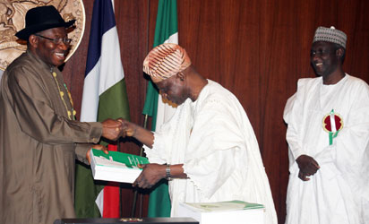 DR. FEMI OKUROUNMU PRESENTING THE REPORT OF THE PRESIDENTIAL COMMITTEE ON NATIONAL DIALOGUE TO PRESIDENT GOODLUCK JONATHAN
