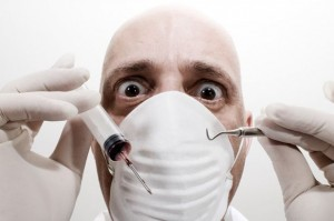 Portrait of Dentist Holding Surgeon and Dental Pick-798836