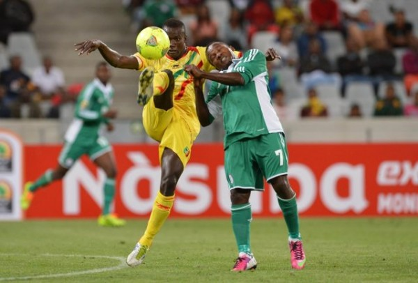 Chrisantus Ejike Uzoenyi Challenges for the Ball During the Opening Day Loss to Mali.