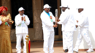 President Jonathan Receives the Queen's Baton from the Sports Minister. Photo: OP via PM News.